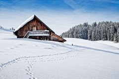 Wooden hut in the austrian alps Stock Photography