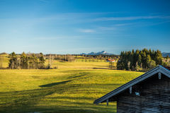 Wooden hut in bavarian landscape Royalty Free Stock Images