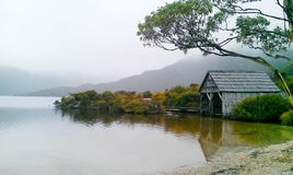 Wooden hut on brown Dove Lake royalty free stock photography