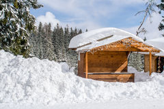 Wooden hut covered with a lot of snow royalty free stock images