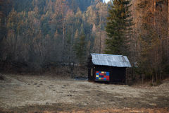 Wooden hut at the edge of a forest Royalty Free Stock Photo