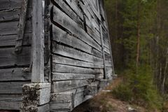 A fragment of a wooden structure in the forest. stock image