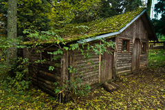 Wooden hut in a forest at mountain Goc Royalty Free Stock Photography