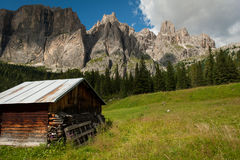 Wooden hut in front of Dolomite mountains royalty free stock images