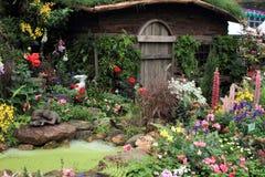 Wooden hut and garden Stock Photo