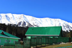 Wooden hut in Gulmarg, India. Mountain village landscape. Heaven on earth royalty free stock images