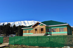 Wooden hut in Gulmarg, India. Mountain village landscape. Heaven on earth royalty free stock photo