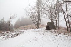 Wooden hut in Harz mountains during foggy winter day Royalty Free Stock Photos