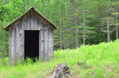 Wooden hut. An isolated and deserted wooden hut in a forest Stock Photos