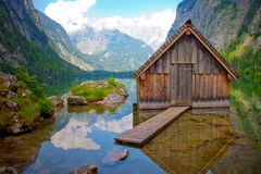 Wooden hut at lake Obersee. Obersee is beautiful lake in Alps, Germany. You have to take electric boat then 20 minutes hiking to arrive there royalty free stock photo