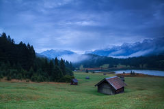 Wooden hut on meadow by Geroldsee lake Royalty Free Stock Photos