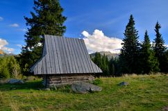 Wooden hut in the mountains. Wooden hut located in the picturesque Rusinowa Glade in Polish Tatra mountais stock images