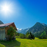 Wooden hut in the mountains Stock Image