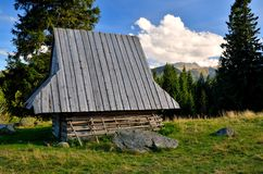 Wooden hut in mountains Royalty Free Stock Images
