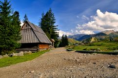 Wooden hut in mountains Royalty Free Stock Image