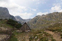 Wooden hut in National Park. Wooden mountain hut in rough, rocky, back country of UNESCO world heritage National Park Durmitor, Montenegro Stock Photos