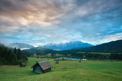 Wooden hut o meadow by Geroldsee lake at sunrise Royalty Free Stock Images