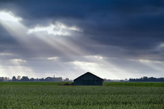 Wooden hut over sky with sunbeams Stock Photo