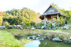 Wooden hut on pond  House of Tribes, Thailand Royalty Free Stock Photography