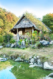 Wooden hut on pond  House of Tribes, Thailand Royalty Free Stock Photo