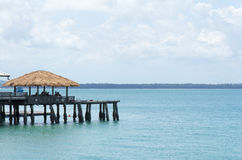 Wooden hut at port. And blue ocean view Royalty Free Stock Photos
