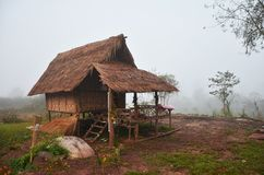 Wooden hut of resort and homestay for travelers people rest. In morning time at Ban Bo Kluea village in Bo Kluea District of Nan, Thailand Stock Photos