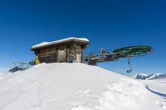 Wooden hut and ski lift stock image