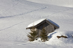 Wooden hut in snow, Alps, Austrian Stock Photos