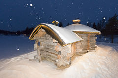 Wooden hut in snow background Royalty Free Stock Photo