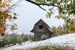 Wooden hut and a snowstorm in the mountains. Carpathians Stock Photo