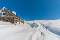 Wooden Hut in Snowy Landscape Stock Photo