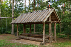 A wooden hut. With a table and benches Stock Image