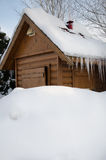 wooden hut under snow Royalty Free Stock Photos