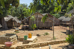 Wooden hut village in tropical Madagascar Stock Photos