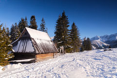 Wooden hut in winter in mountain Royalty Free Stock Images