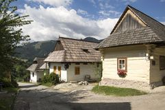 Wooden mountains huts in beautiful Vlkolinec traditional village in Slovakia. Wooden huts in beautiful Vlkolinec traditional village in Slovakia, folk houses Royalty Free Stock Photos