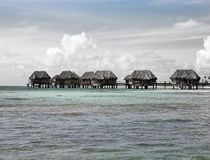 Wooden huts in the sea, with a retro effect.Sea tropical landscape in a sunny day Stock Images