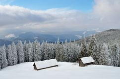 Wooden huts in winter mountains Royalty Free Stock Image