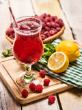 On wooden is ice cold beverage glass with berries cocktail . Royalty Free Stock Photos