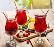 On wooden is ice cold beverage glass with berries cocktail . Royalty Free Stock Photo
