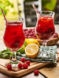On wooden are ice cold beverage glasses with berries cocktail . Royalty Free Stock Photos