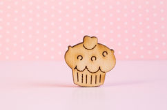 Wooden icon of cake on pink background Royalty Free Stock Photo