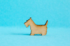 Wooden icon of dog on blue background Royalty Free Stock Images