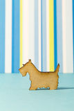 Wooden icon of dog on blue striped background Stock Photo