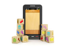 Wooden icons and mobile phone Stock Photography