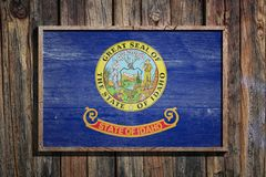 Wooden Idaho flag. 3d rendering of a Idaho State USA flag on a wooden frame and a wood wall Stock Photo