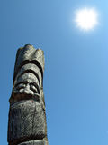 Wooden idol. On the background of blue sky Stock Photo