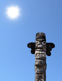 Wooden idol. On the background of blue sky Stock Photos