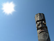 Wooden idol. On the background of blue sky Royalty Free Stock Photography