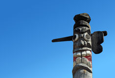 Wooden idol. On the background of blue sky Stock Image